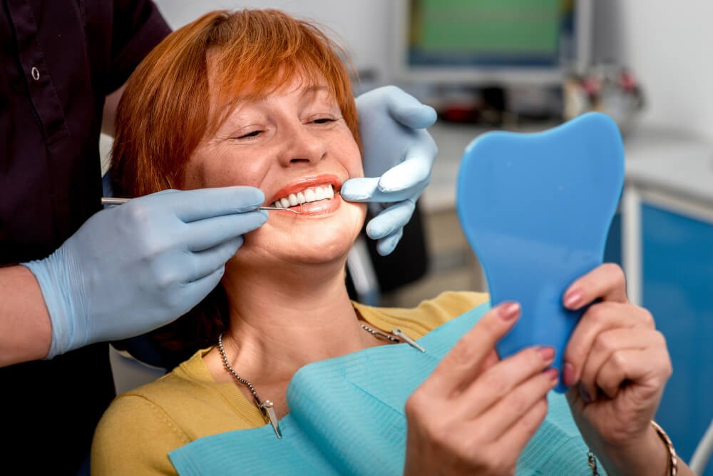 Woman Smiles at Dentist Photo